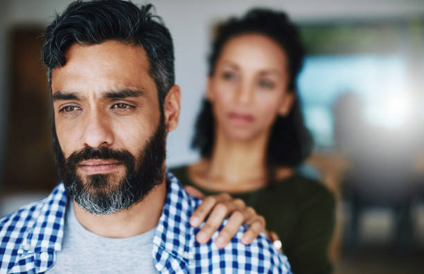 Don't keep it all bottled up Shot of a woman comforting her distraught husband at home husband stock pictures, royalty-free photos & images