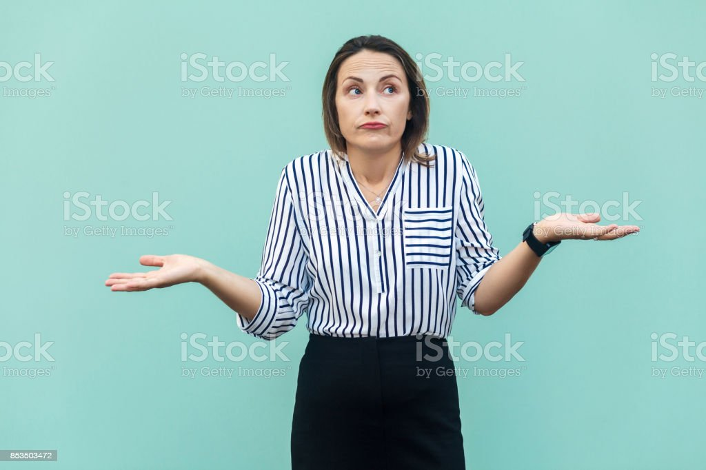 I Dont Know. Handsome blonde businesswoman with looking at camera and confused. stock photo