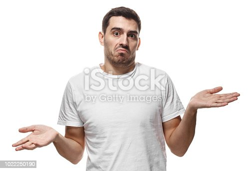 I don't know. Young man isolated on white background, showing helpless gesture with arm and hands, mouth curved as if he does not know what to do