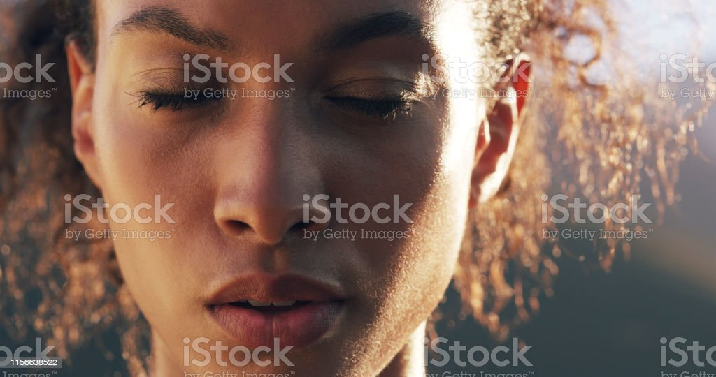Don't let them get into your head Closeup shot of a sporty young woman out for a run 20-29 Years Stock Photo