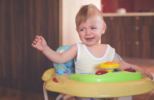 I don't like baby walker stock photo