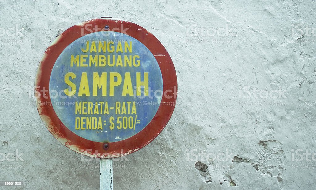 Don't Litter: Malay sign in Malacca, Malaysia stock photo