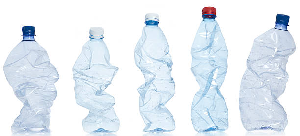 Don't mix plastic with other waste. Empty plastic bottles isolated on white. crushed stock pictures, royalty-free photos & images