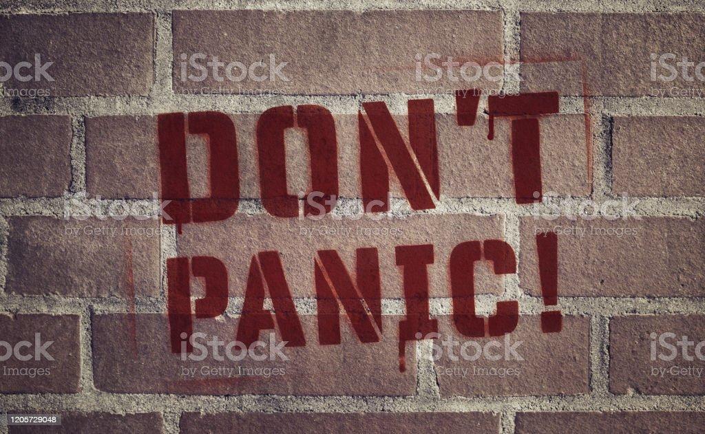 """Don't Panic!"" Stencil Spray-Painted on Brick Wall - Royalty-free Brick Stock Photo"