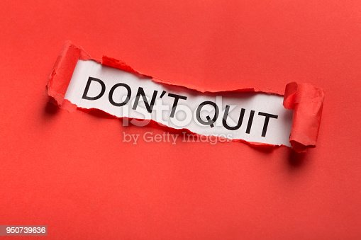 Motivational poster with Dont quit phrase appearing behind torn red paper. Inspiration and support concept, copy space