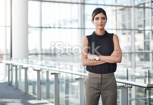 Shot of a beautiful businesswoman standing in an office