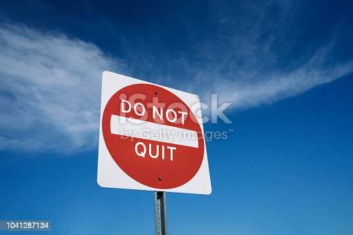 Motivational road sign concept to never give up and don't quit