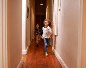Shot of two children running down a hallwayhttp://195.154.178.81/DATA/istock_collage/1160003/shoots/783959.jpg