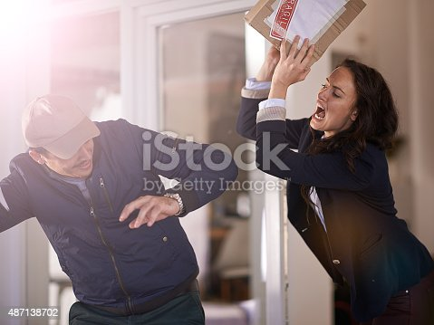 Cropped shot of a woman reacting angrily toward her delivery manhttp://195.154.178.81/DATA/i_collage/pi/shoots/805506.jpg