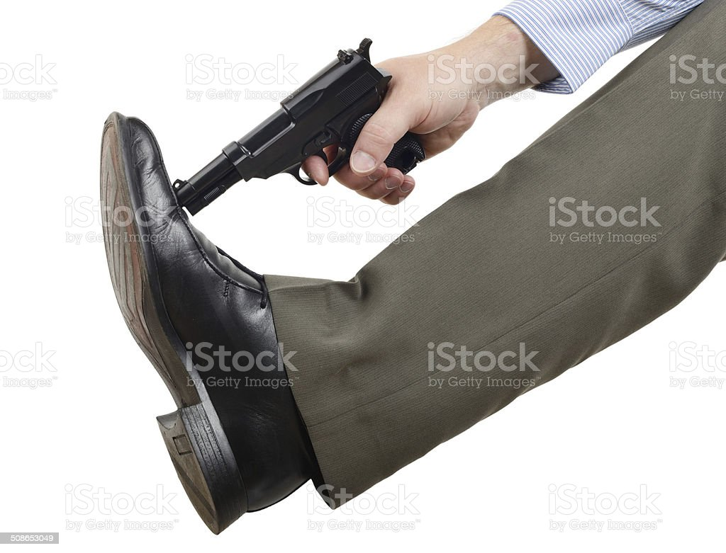 Don't shoot yourself in the foot stock photo