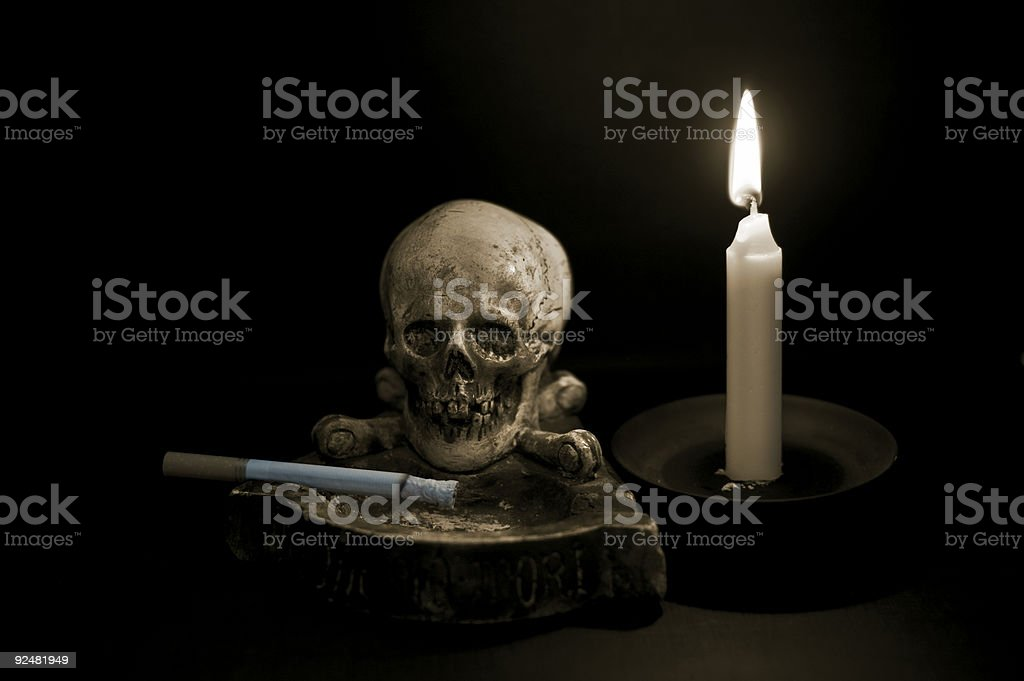 Don't smoke / Skull and candle royalty-free stock photo