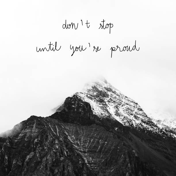 dont stop until you re proud on mountains view - stimulus stock pictures, royalty-free photos & images
