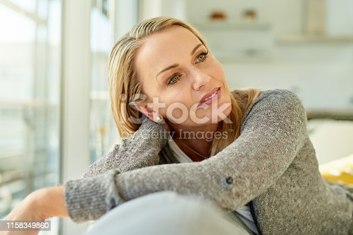 Shot of a woman enjoying a relaxing day at home