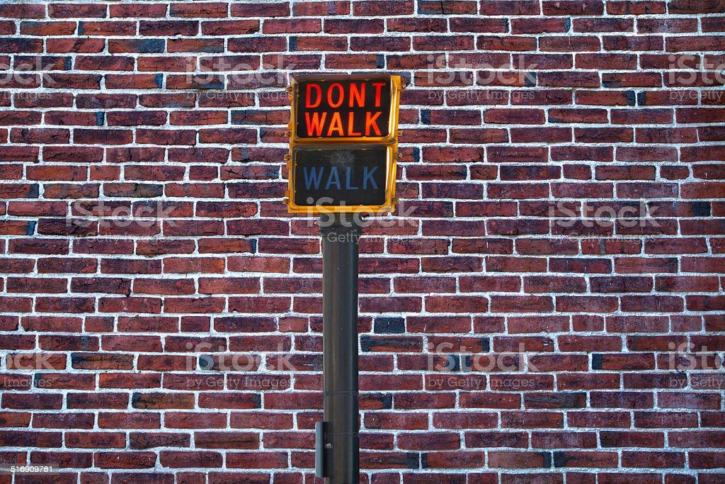 Don't walk on a brick wall stock photo