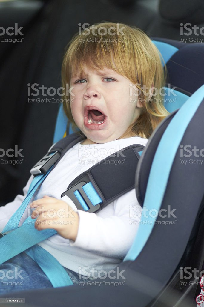 I don't wanna sit here! Let me out! stock photo