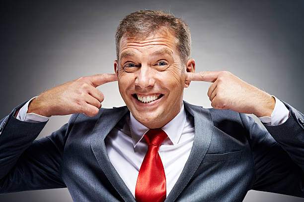 i don't want to hear it! - covering ears stock photos and pictures