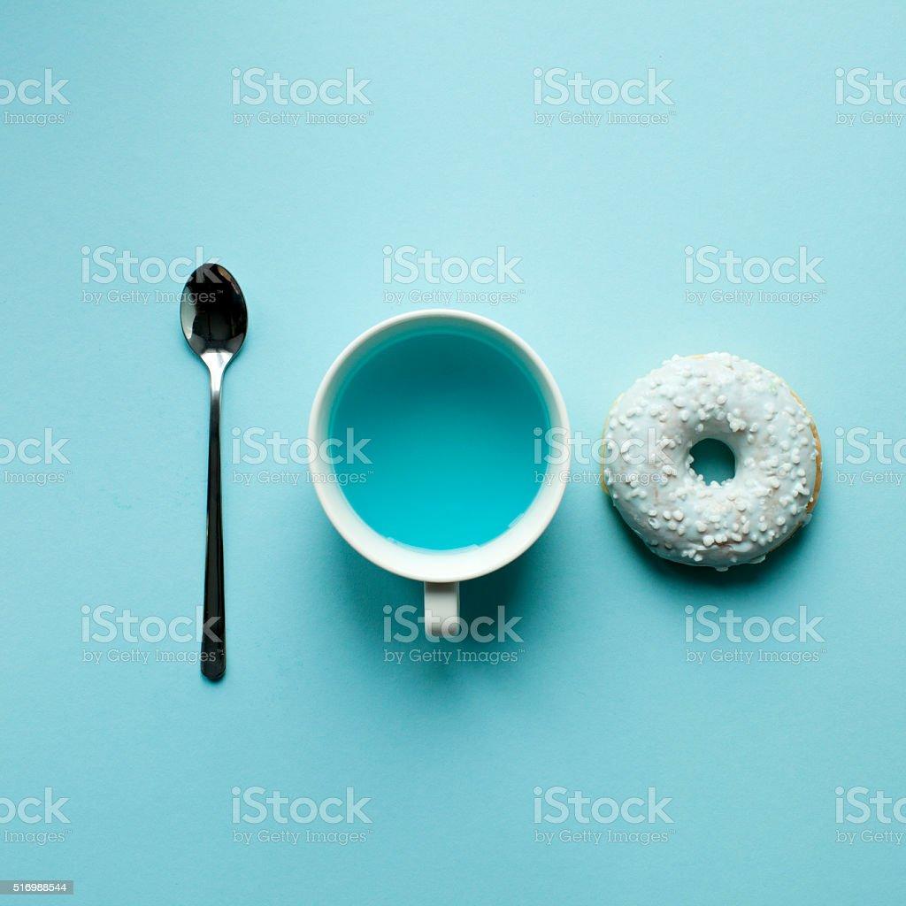 Donut and blue tea stock photo