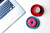 donut, cup of coffee and laptop