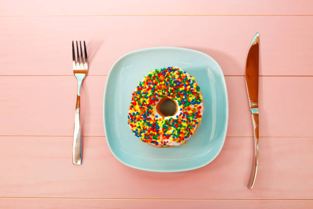 Donut dish and silverware stock photo
