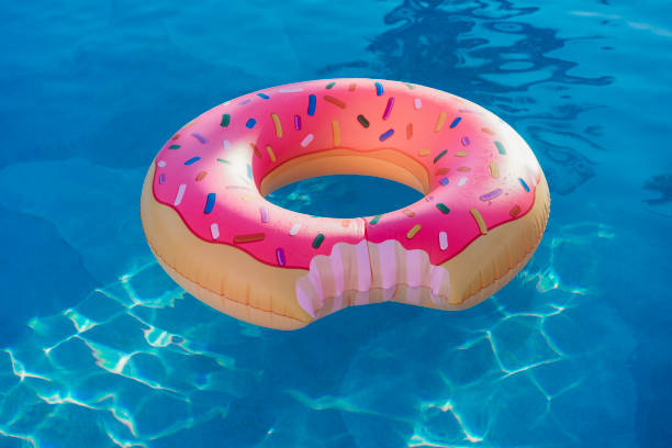 Donut inflatable on swimming pool stock photo