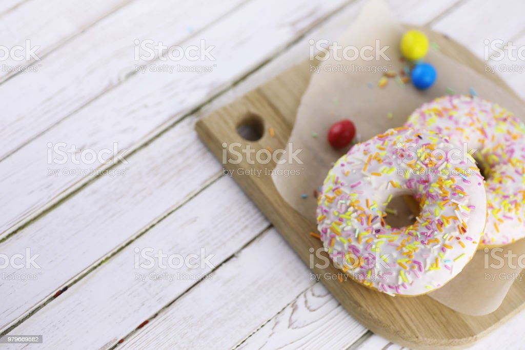 Donut on a wooden white background stock photo