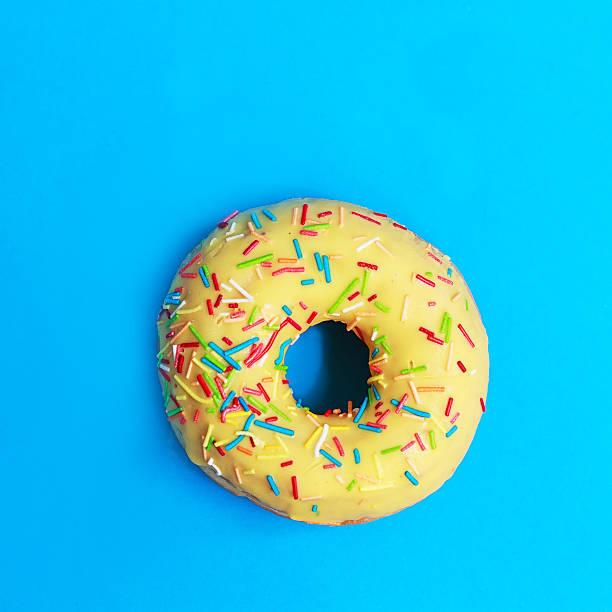 Donut on blue background stock photo