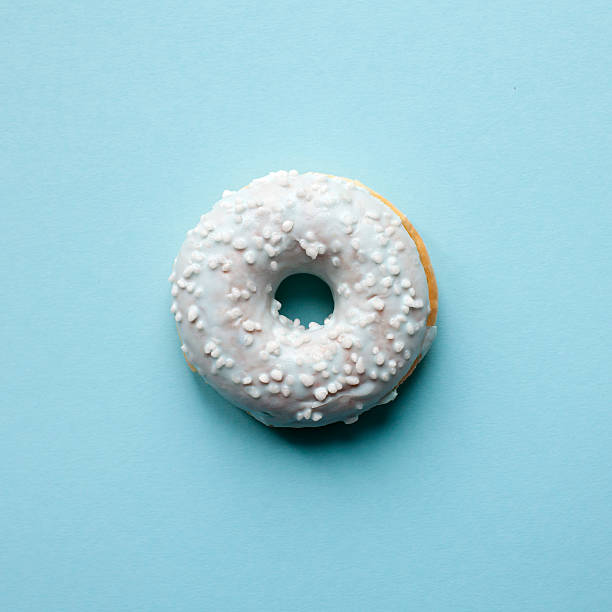 Donut on blue table stock photo