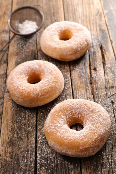 donut on wood background stock photo