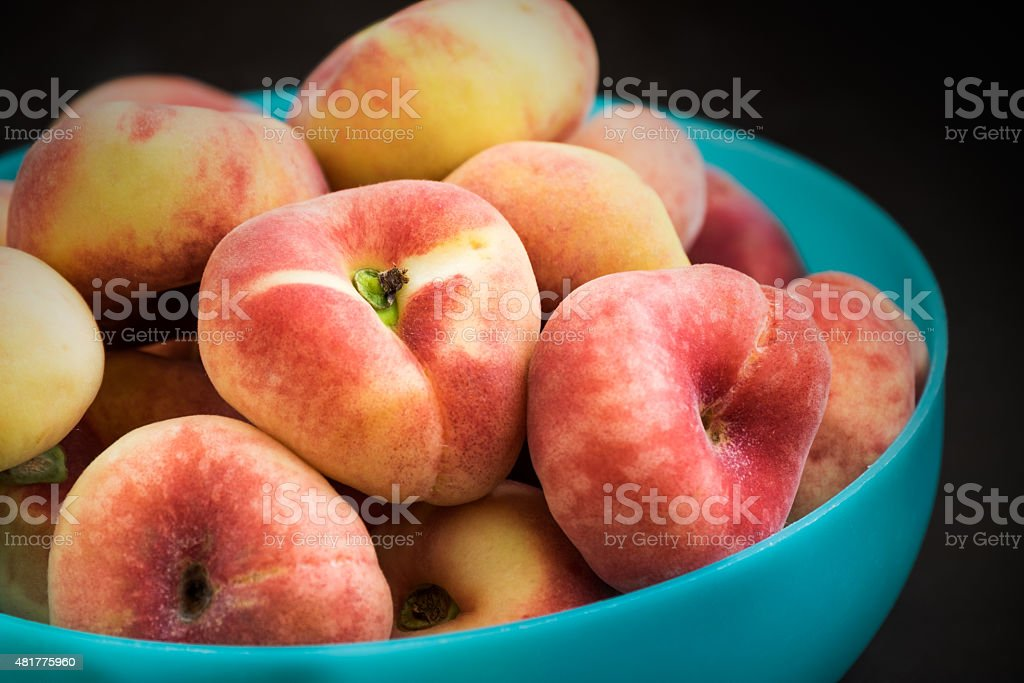 Donut peaches in bowl stock photo