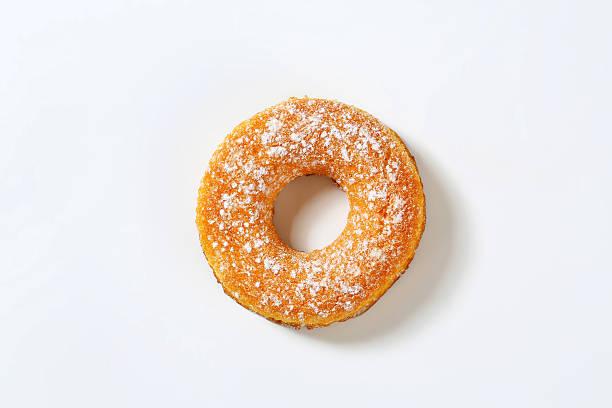 krapfen und doughnuts - löcherkuchen stock-fotos und bilder