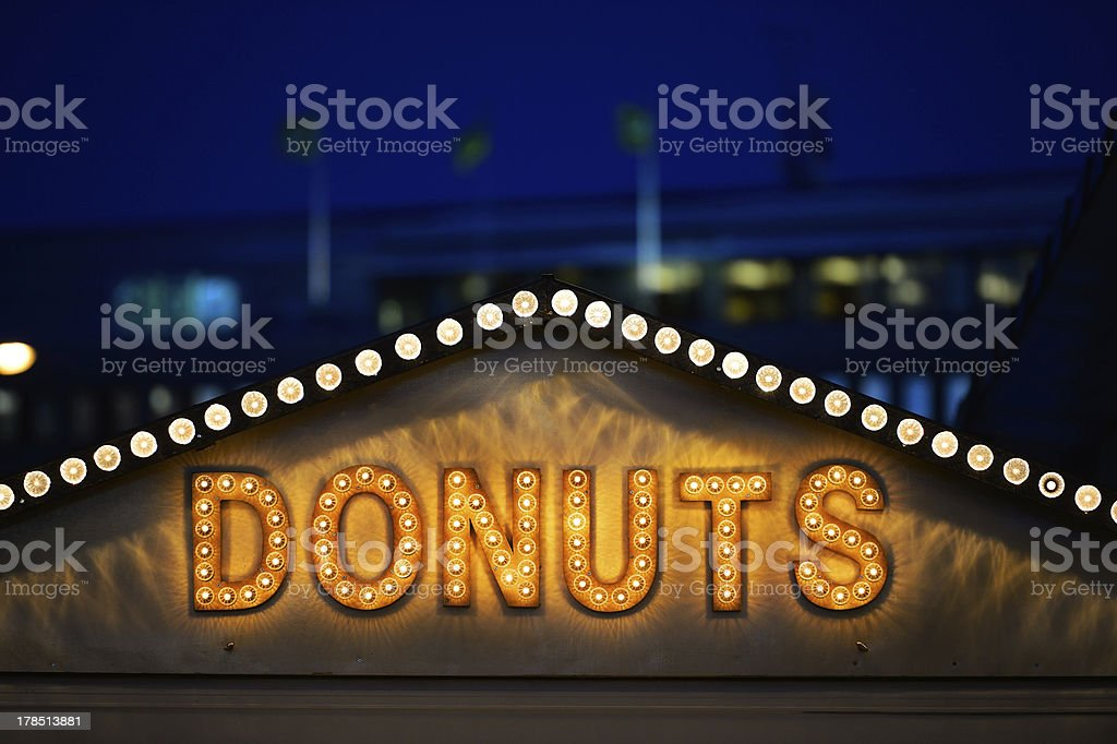 Donut sign in the evening royalty-free stock photo