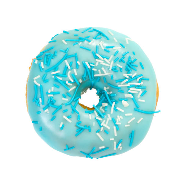 Donut with blue glaze and blue and white sprinkles stock photo