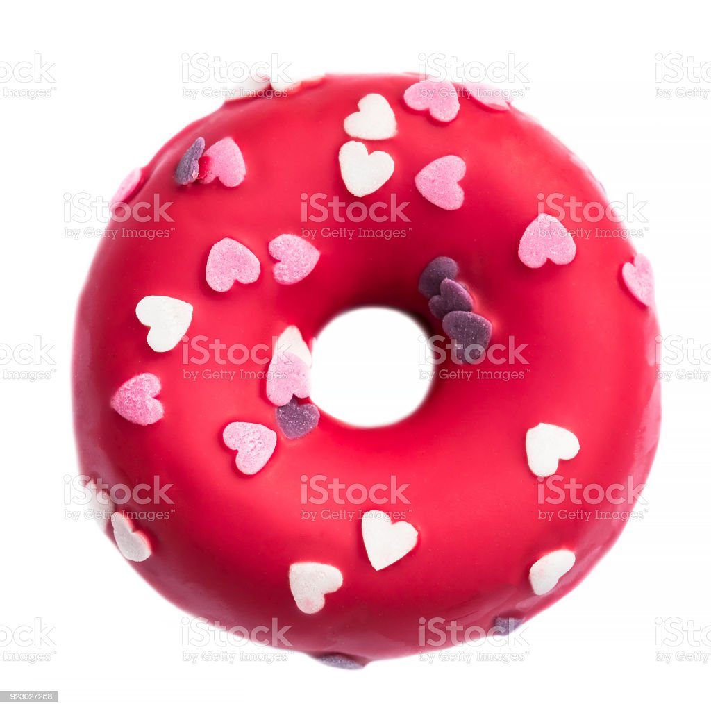 Donut with heart sprinkles isolated on white background. Donut for bakery menu. Valentine Day food  idea. Funny donut'n stock photo