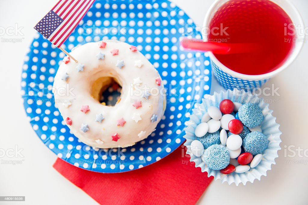 donut with juice and candies on independence day stock photo
