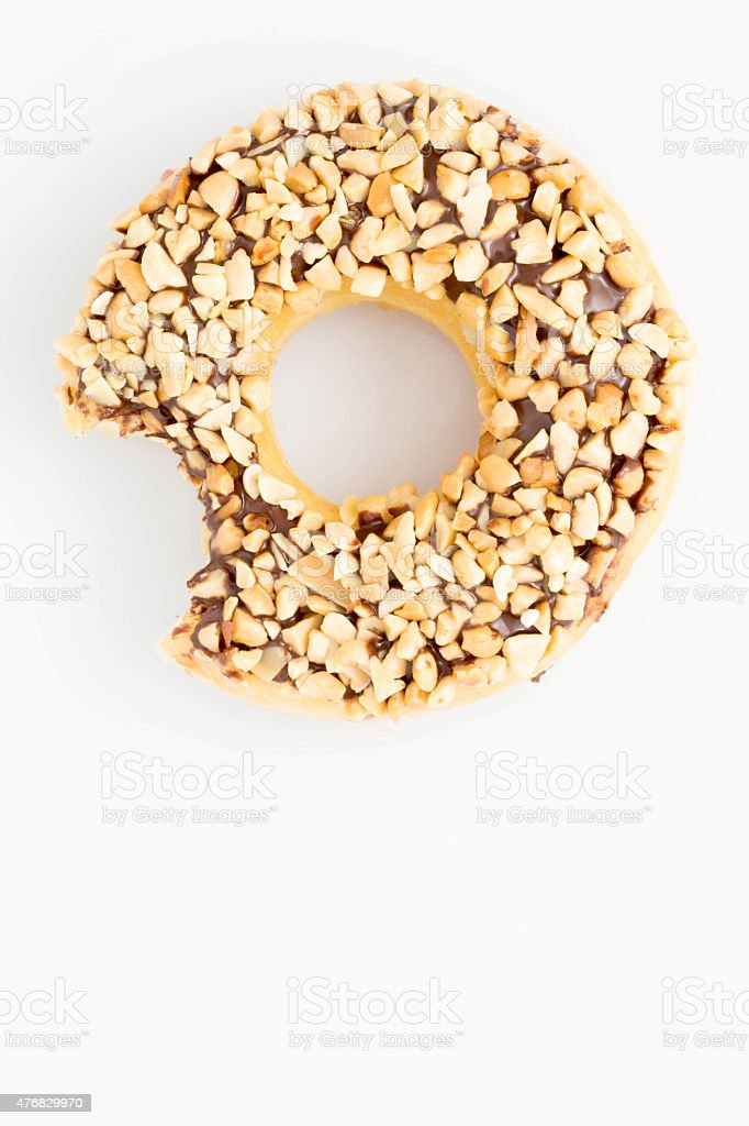 Donut with one bite missing stock photo