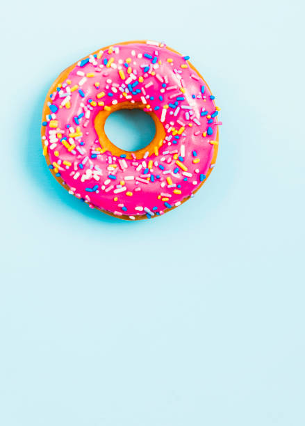 Donut with pink icing and copy space stock photo