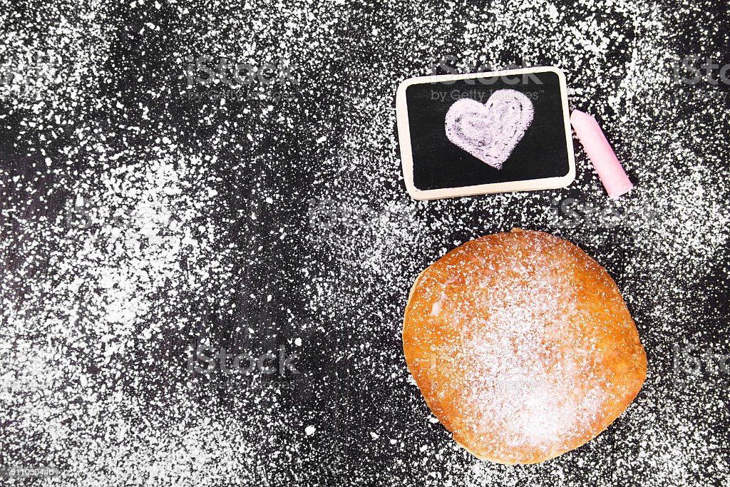 donut with powdered sugar and heart drawing stock photo