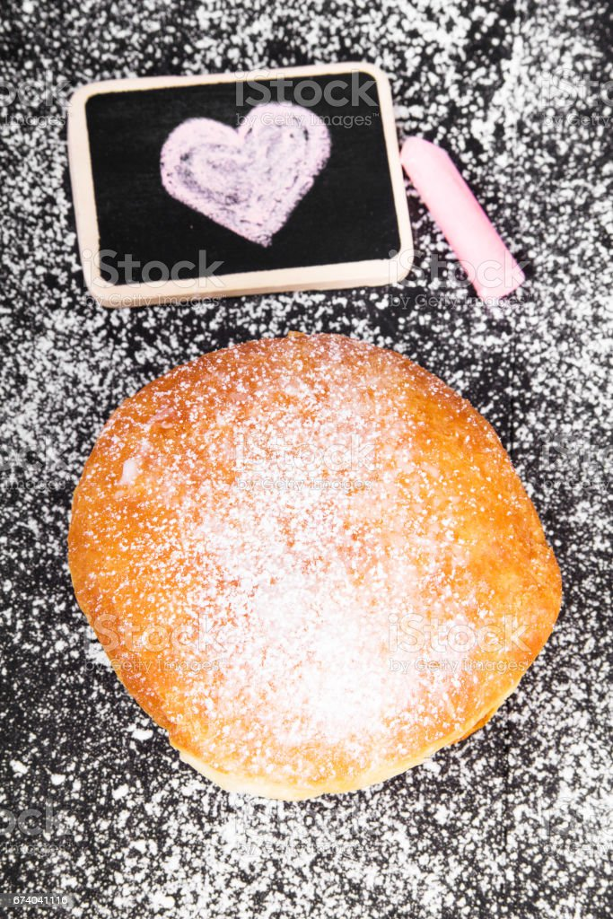 donut with powdered sugar and heart drawing royalty-free stock photo