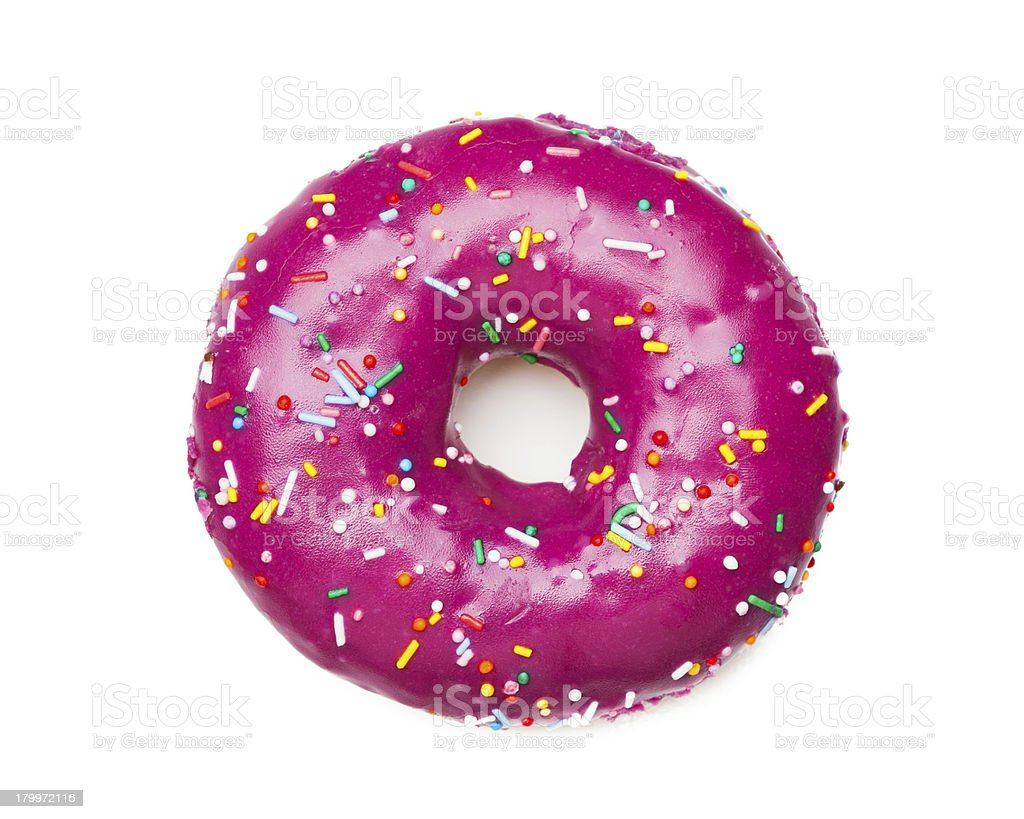 Donut with purple icing and colorful sprinkles stock photo