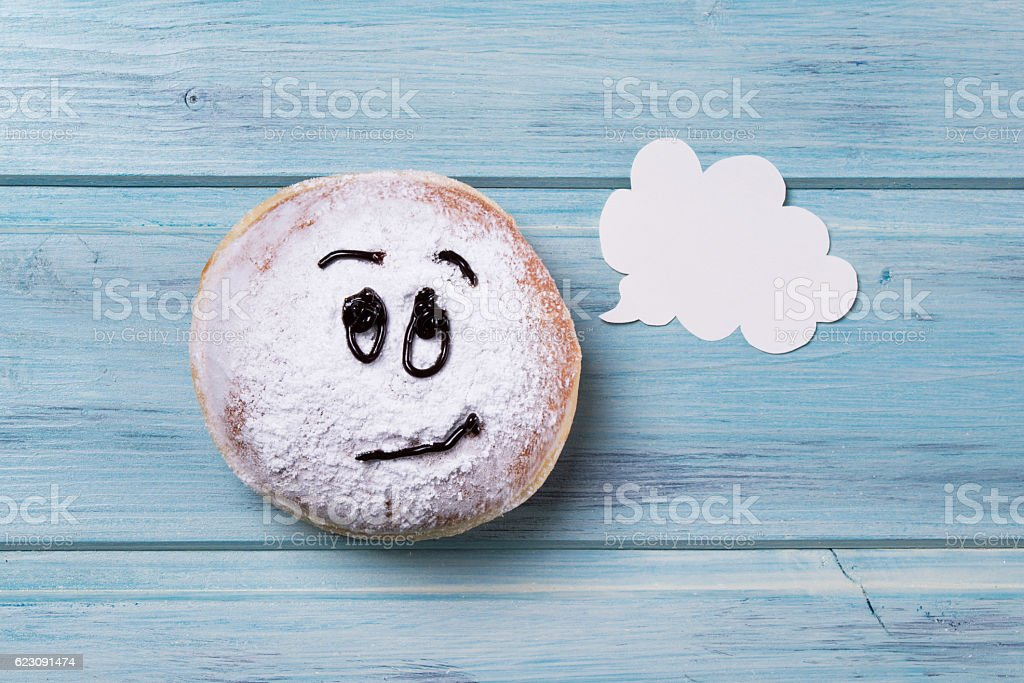Donut With Smiley Face And Text Cloud Wooden Background Stockfoto