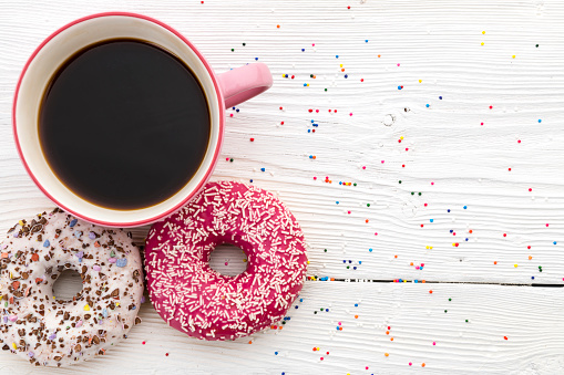 istock Donuts and a cup of coffee close-up 1047684854