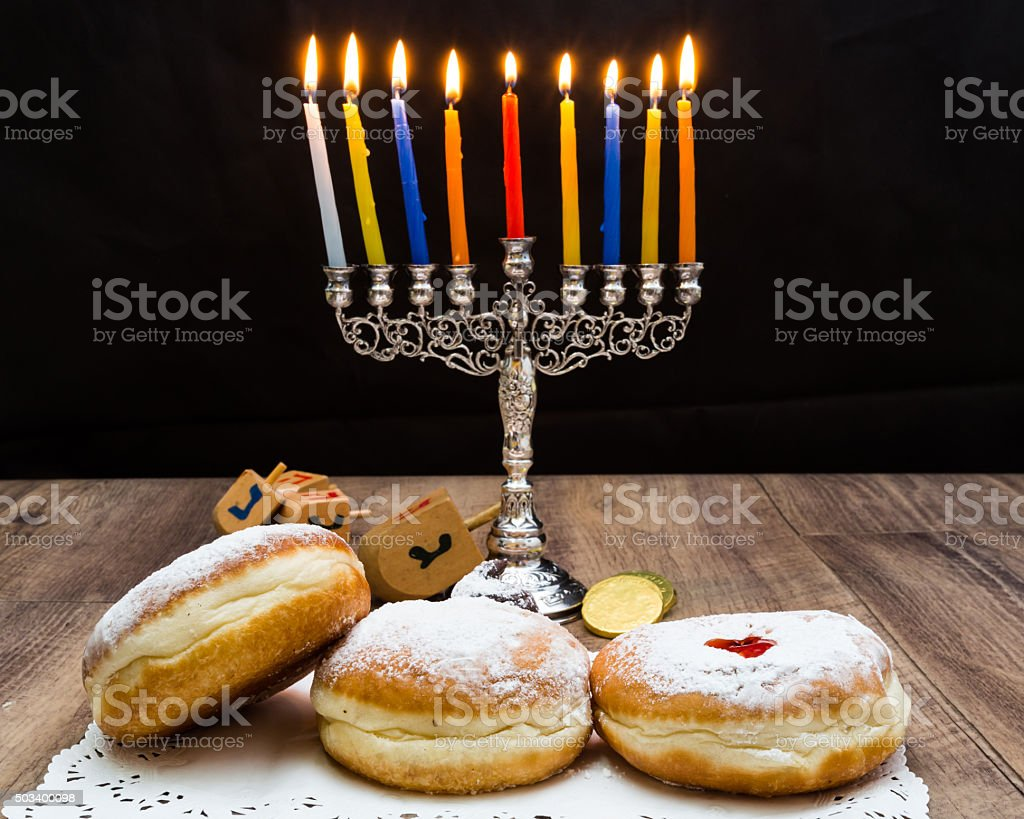 Donuts and a menorah for Hanukkah stock photo