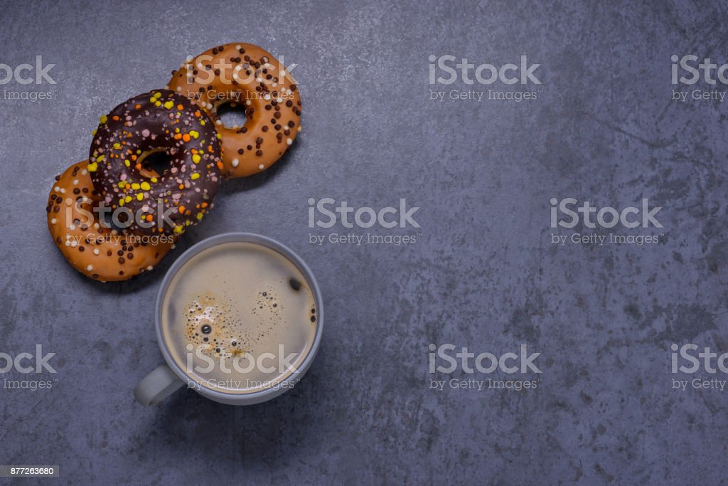 Donuts and coffee on table. Breakfast concept stock photo