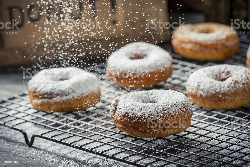 Donuts decorated with powder sugar stock photo
