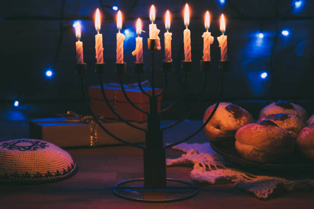 donuts for hanukkah celebration - hanukkah stock pictures, royalty-free photos & images