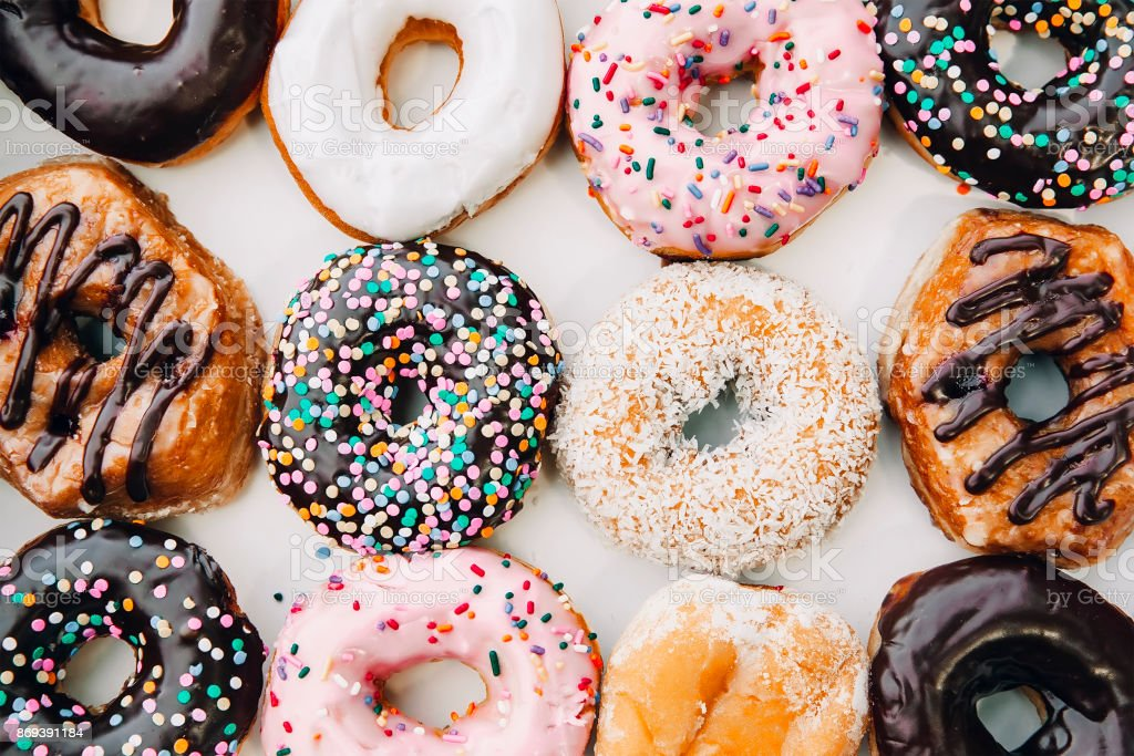 donuts in multicolored glaze and sprinkling stock photo