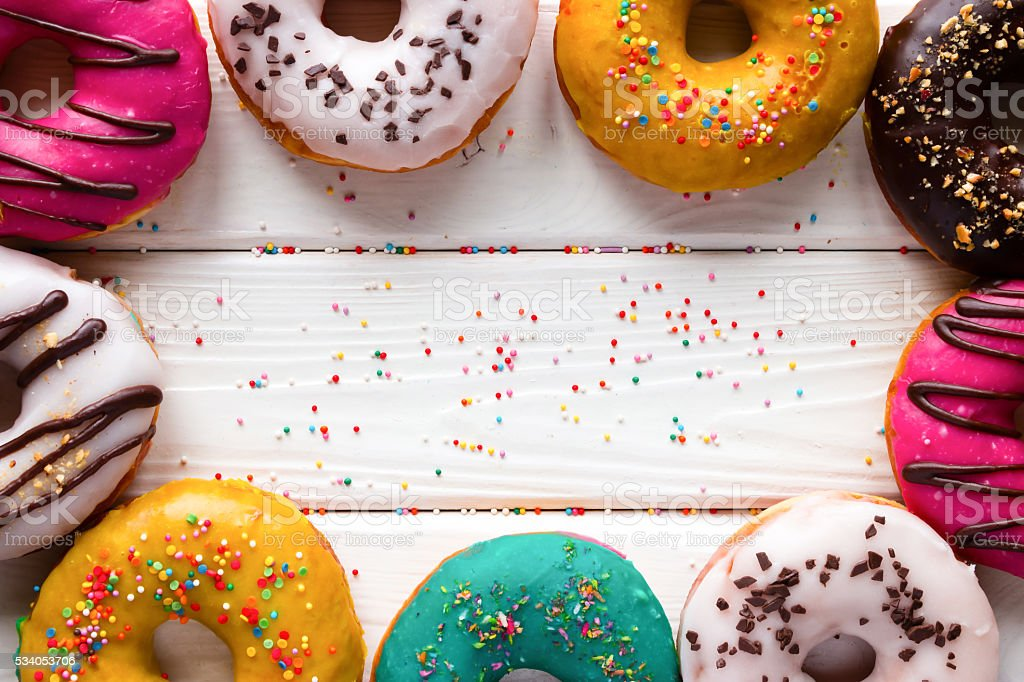 donuts on a wooden background and space for text stock photo