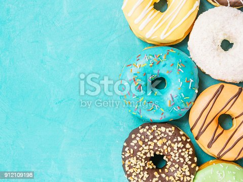 istock donuts on blue background , copy space, top view 912109198