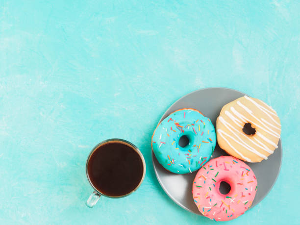 donuts on blue background , copy space, top view stock photo