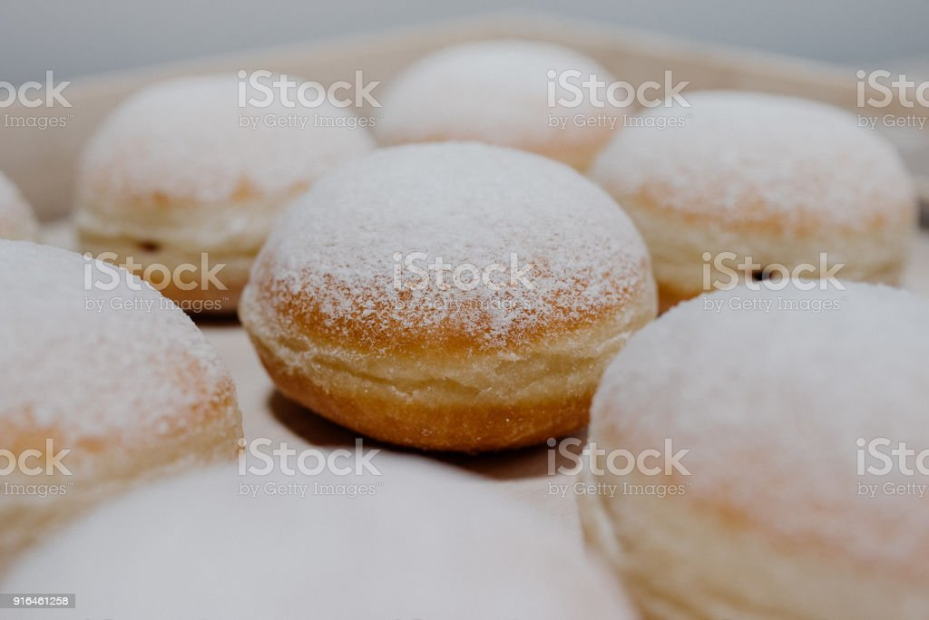 Donuts on plate on woode board stock photo